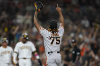 San Francisco Giants relief pitcher Camilo Doval (75) reacts after San Diego Padres' Tommy Pham grounded into a double play with the bases loaded to end the fifth inning of a baseball game Wednesday, Sept. 22, 2021, in San Diego. (AP Photo/Gregory Bull)
