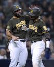 San Diego Padres' Eric Hosmer, left, and Fernando Tatis Jr. celebrate after scoring on a single by Manuel Margot during the second inning of the team's baseball game against the San Francisco Giants on Friday, March 29, 2019, in San Diego. (AP Photo/Orlando Ramirez)