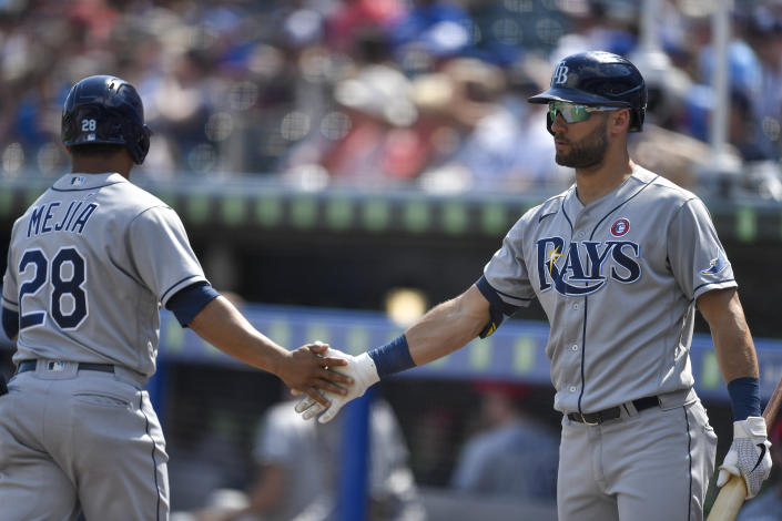 Tampa Bay Rays' Francisco Mejia (28) is congratulated by Kevin Kiermaier after scoring against the Toronto Blue Jays on a sacrifice fly by Mike Brosseau during the ninth inning of a baseball game in Buffalo, N.Y., Sunday, July 4, 2021. (AP Photo/Adrian Kraus)