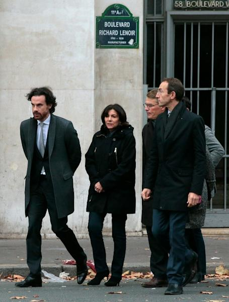 Paris mayor Anne Hidalgo (C) arrives at the scene of the Bataclan concert hall shootings on November 14, 2015, a day after a string of coordinated attacks left more than 120 people dead in the worst such violence in France's history