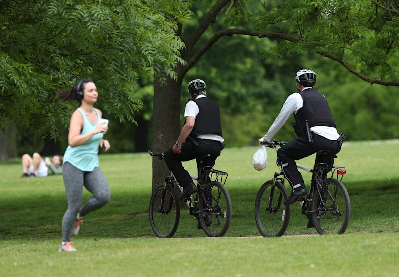 Police officers on bicycles on patrol in Hyde Park, London, as the UK continues in lockdown to help curb the spread of the coronavirus.