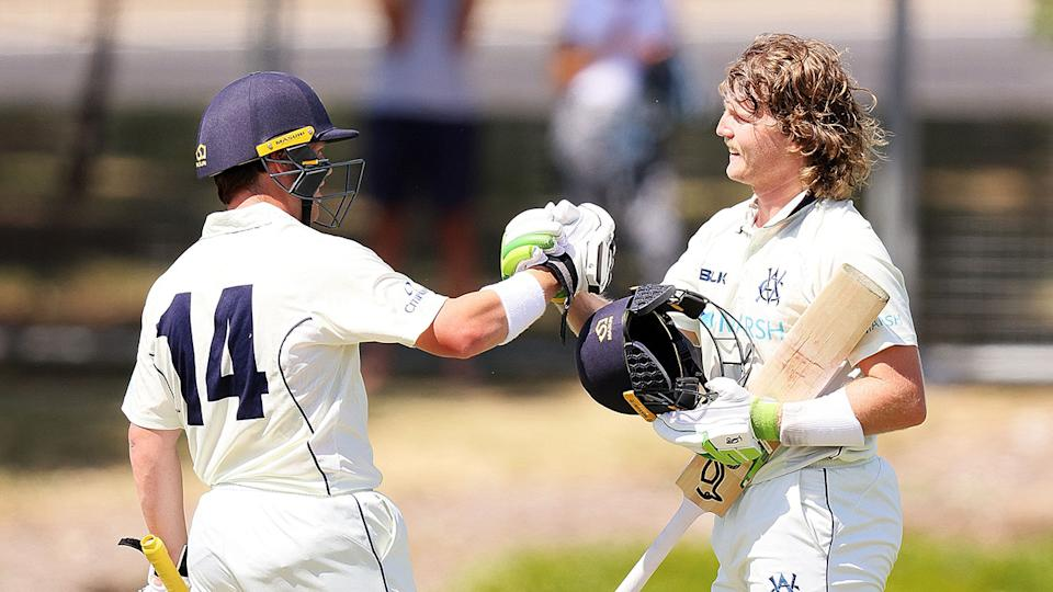 Seen here, Will Pucovski celebrates his double ton with a Victoria teammate.