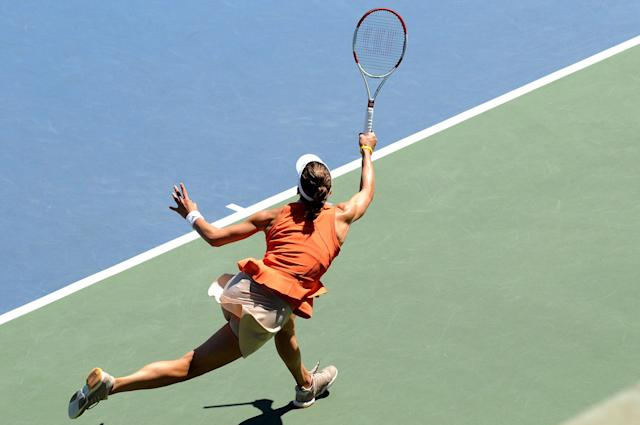 Andrea Petkovic returns to Serena Williams during the Bank of the West Classic at the Taube Family Tennis Stadiumon August 2, 2014 in Stanford, California (AFP Photo/Noah Graham)
