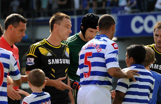 <p>For the second time in his career, a missed handshake was the talk of the town. Terry was banned for four games after being found guilty of racially abusing Ferdinand and the QPR defender refused to shake his hand next time they met. The incident had seen him stripped of the England captaincy for the second time before Euro 2012, after being reinstated by Fabio Capello. (Getty Images) </p>