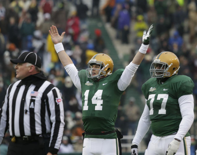 Baylor quarterback Bryce Petty (14) celebrates a play as teammate Kelvin Palmer (77) stands by during the first half of an NCAA college football game against Texas, Saturday, Dec. 7, 2013, in Waco, Texas. (AP Photo/LM Otero)