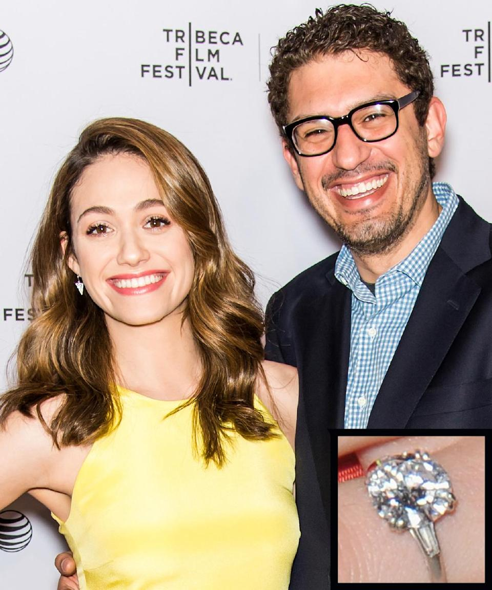 """<p><em>Mr. Robot </em>creator Sam Esmail proposed to actress Emmy Rossum <a rel=""""nofollow noopener"""" href=""""http://www.instyle.com/news/emmy-rossum-flashes-engagement-ring"""" target=""""_blank"""" data-ylk=""""slk:in August 2015"""" class=""""link rapid-noclick-resp"""">in August 2015</a> with a large round stone flanked by two slim baguettes on a platinum band.</p>"""