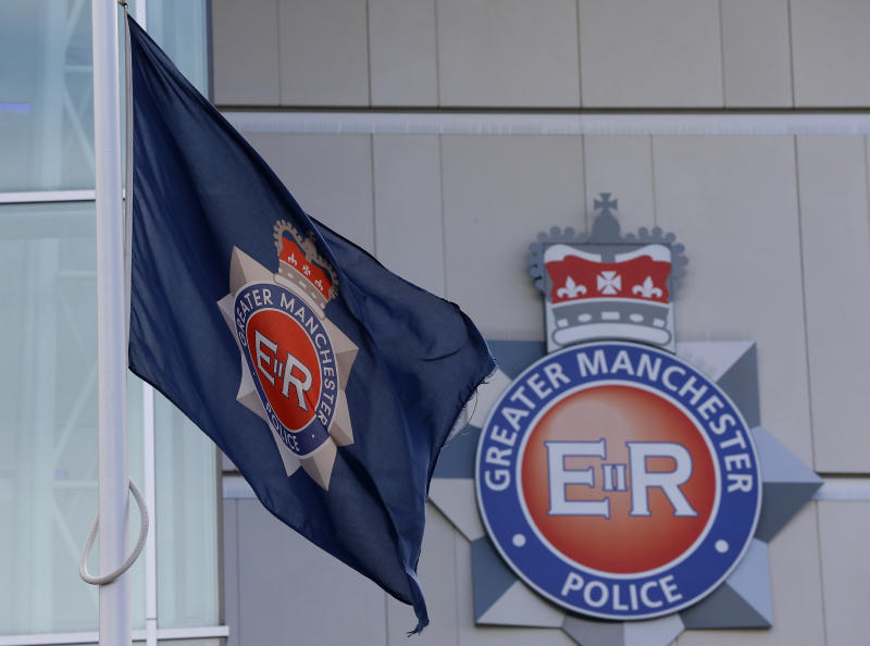 The force flag flies at half mast outside the Greater Manchester Police force headquarters in Manchester , northern England, September 19, 2012. One of Britain's most wanted fugitives killed two unarmed policewomen on Tuesday in a gun and grenade ambush, police said, killings which are likely to reignite a long-running debate over whether British officers should carry guns. REUTERS/Phil Noble (BRITAIN - Tags: CRIME LAW)