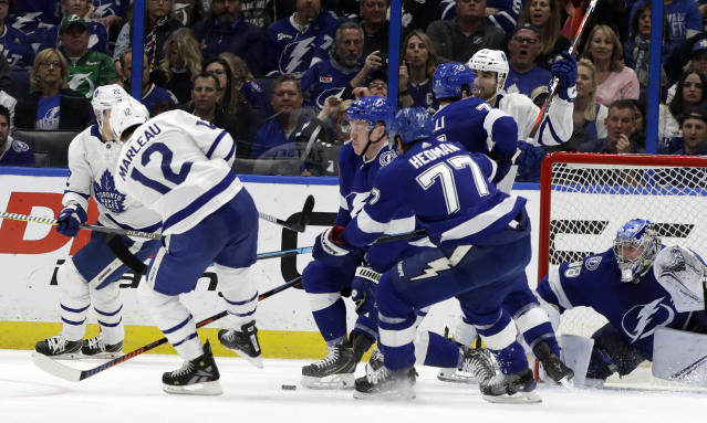 Toronto Maple Leafs center Patrick Marleau (12) watches his shot eventually get past Tampa Bay Lightning goaltender Andrei Vasilevskiy (88) for a goal during the second period of an NHL hockey game, Thursday, Jan. 17, 2019, in Tampa, Fla. (AP Photo/Chris O'Meara)