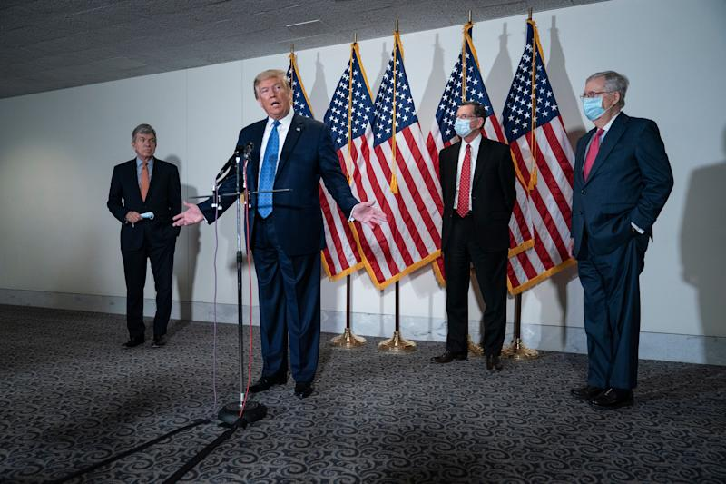 President Trump speaks to the press after a policy meeting with Republican senators Tuesday. (Drew Angerer via Getty Images)
