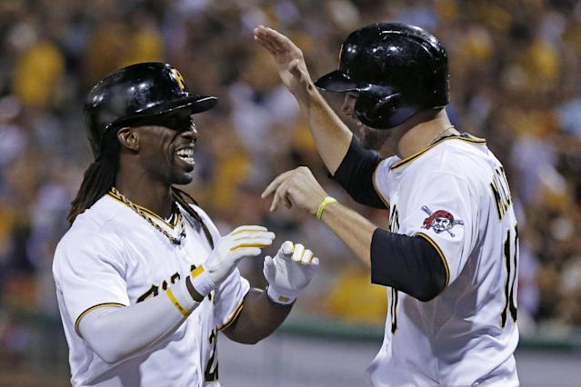 Pittsburgh Pirates' Andrew McCutchen, left, celebrates with Jordy Mercer after hitting a two-run home run off St. Louis Cardinals starting pitcher Tyler Lyons during the fifth inning of the second baseball game of a doubleheader in Pittsburgh, Tuesday, July 30, 2013. (AP Photo/Gene J. Puskar)