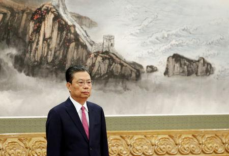 New Politburo Standing Committee member Zhao Leji attends a meeting with media in Beijing