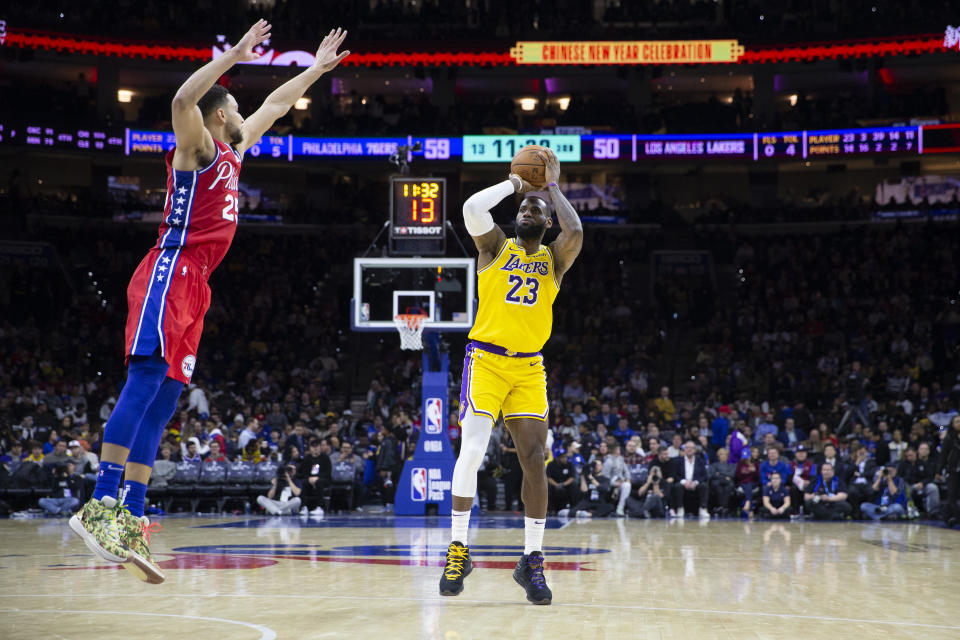 LeBron James #23 of the Los Angeles Lakers shoots the ball against Ben Simmons #25 of the Philadelphia 76ers at the Wells Fargo Center.