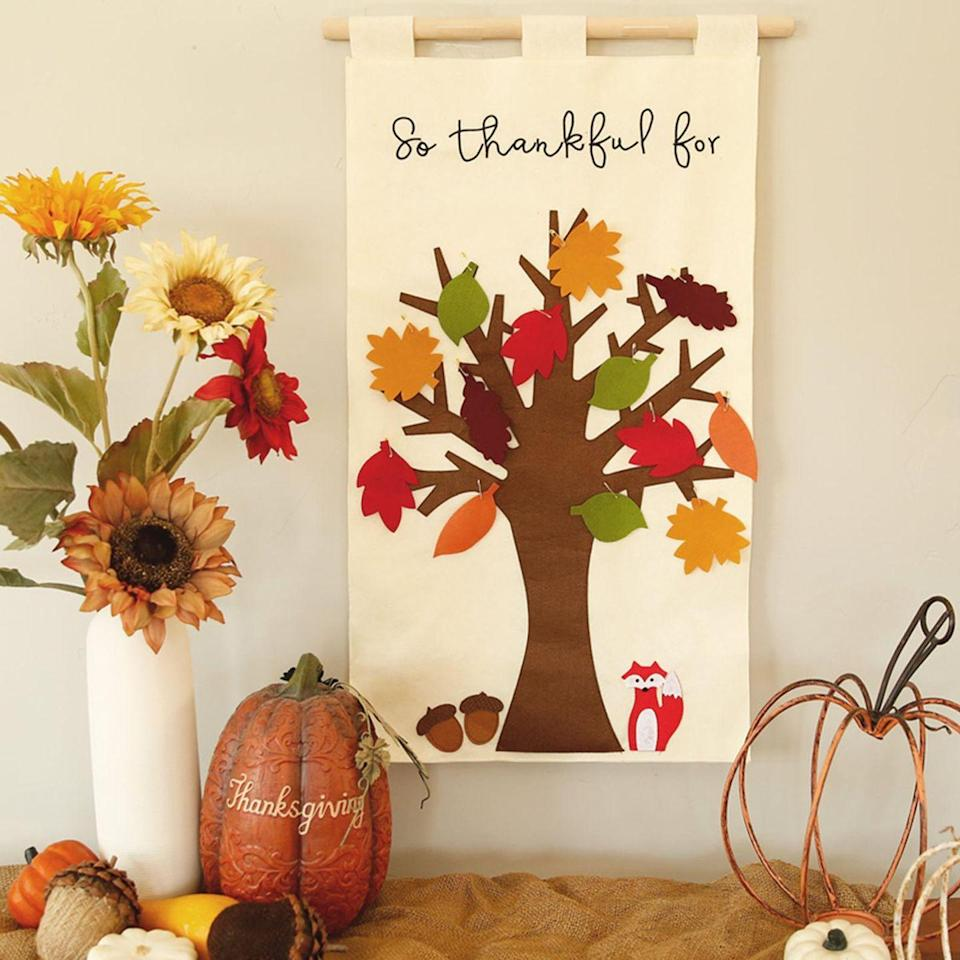 "<p>Skip the DIY centerpiece and go for ready-made <a href=""https://www.goodhousekeeping.com/home/decorating-ideas/g30445806/diy-wall-decor-ideas/"" rel=""nofollow noopener"" target=""_blank"" data-ylk=""slk:wall decor"" class=""link rapid-noclick-resp"">wall decor</a> instead, made so easy to customize with felt leaves that you can tack on with gold safety pins. The best part, though? You can roll it all up and store it compactly once the season is over, and then bring it out again for the holiday year after year. </p><p><a class=""link rapid-noclick-resp"" href=""https://go.redirectingat.com?id=74968X1596630&url=https%3A%2F%2Fwww.etsy.com%2Flisting%2F634066480%2Fthankful-tree-thanksgiving-tradition&sref=https%3A%2F%2Fwww.goodhousekeeping.com%2Fholidays%2Fthanksgiving-ideas%2Fg33525114%2Fthankful-thanksgiving-tree-ideas%2F"" rel=""nofollow noopener"" target=""_blank"" data-ylk=""slk:BUY NOW ON ETSY"">BUY NOW ON ETSY</a> </p>"