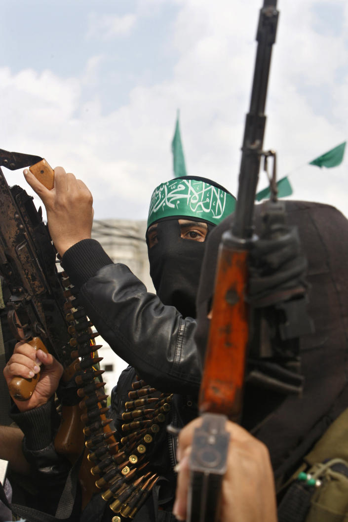 A Palestinian militant of the Izzedine Al-Qassam Brigades, the armed wing of Hamas, attends funerals of five Hamas militants in Mugharka village, central Gaza Strip, Thursday, Nov. 22, 2012. Five Hamas militants were killed in an Israeli air strike yesterday, Palestinian health officials said. (AP Photo/Adel Hana)