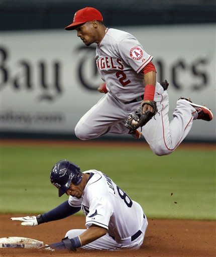 Los Angeles Angels shortstop Erick Aybar flies through the air after forcing out Tampa Bay Rays' Desmond Jennings at second base on a fifth-inning fielder's choice during a baseball game, Thursday, April 26, 2012, in St. Petersburg, Fla. Aybar threw to third baseman Alberto Callaspo to tag out Rays' Sean Rodriguez (AP Photo/Chris O'Meara)