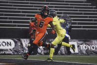 Oregon State running back Jermar Jefferson (6) runs past Oregon cornerback Mykael Wright (2) and into the end zone for a touchdown during the first half of an NCAA college football game in Corvallis, Ore., Friday, Nov. 27, 2020. (AP Photo/Amanda Loman)