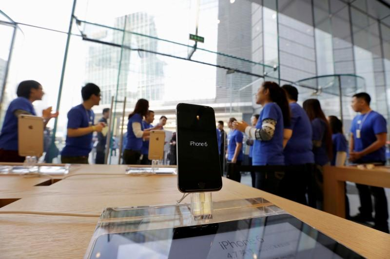 Sales staff welcome the customers to buy iPhone 6 and iPhone 6 Plus at an Apple store in Beijing