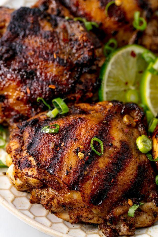 """<p>No time to make it to the Caribbean? We've got you covered. This recipe gets its sweetness from cinnamon and allspice and its spiciness from jalapeño and a whole bunch of spring onions. Two hours of marinating in this special blend makes for a perfect bite of tender grilled chicken.</p><p>Get the <a href=""""https://www.delish.com/uk/cooking/recipes/a28909193/authentic-jerk-chicken-recipe/"""" rel=""""nofollow noopener"""" target=""""_blank"""" data-ylk=""""slk:Jerk Chicken"""" class=""""link rapid-noclick-resp"""">Jerk Chicken</a> recipe.</p>"""