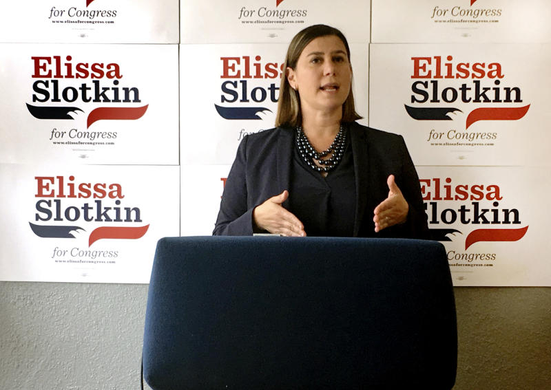 In this July 31, 2018, photo, Elissa Slotkin, a Democratic candidate for Congress from Michigan, speaks during a news conference at her campaign headquarters in Lansing, Mich. The former CIA analyst and Pentagon official is one of dozens of first-time candidates running in districts that seem to offer the best chance for flipping GOP seats this fall. (AP Photo/Mike Householder)