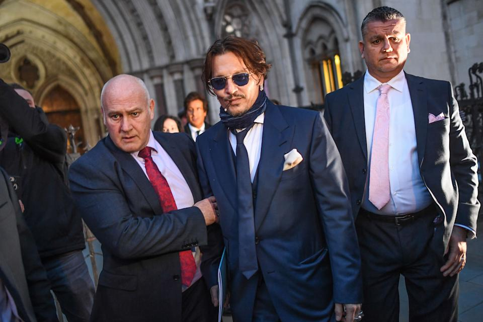 Johnny Depp leaves the Royal Courts of Justice on Feb. 26, 2020 in London, England. The actor is suing the Sun newspaper over claims he abused his ex-wife Amber Heard.