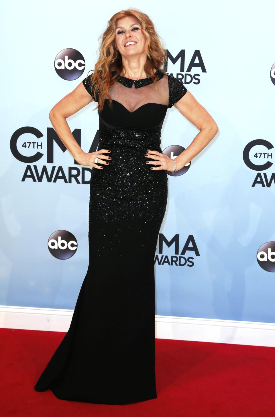 Connie Britton poses on arrival at the 47th Country Music Association Awards in Nashville, Tennessee November 6, 2013. REUTERS/Eric Henderson (UNITED STATES - Tags: ENTERTAINMENT)