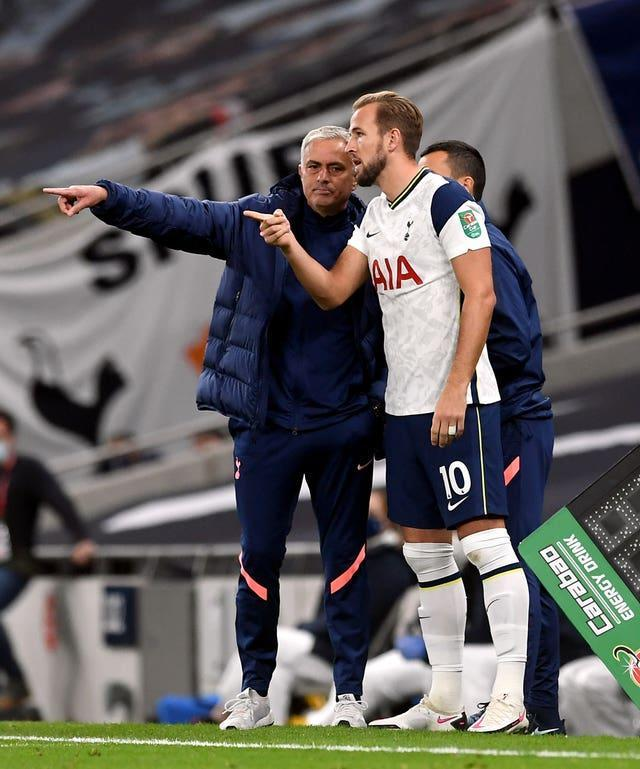 Harry Kane, right, remains in contact wit former Tottenham manager Jose Mourinho