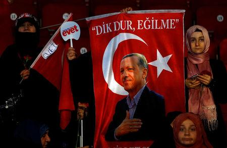 Supporters of Turkish President Tayyip Erdogan listen to his speech during a Women's Day rally in Istanbul