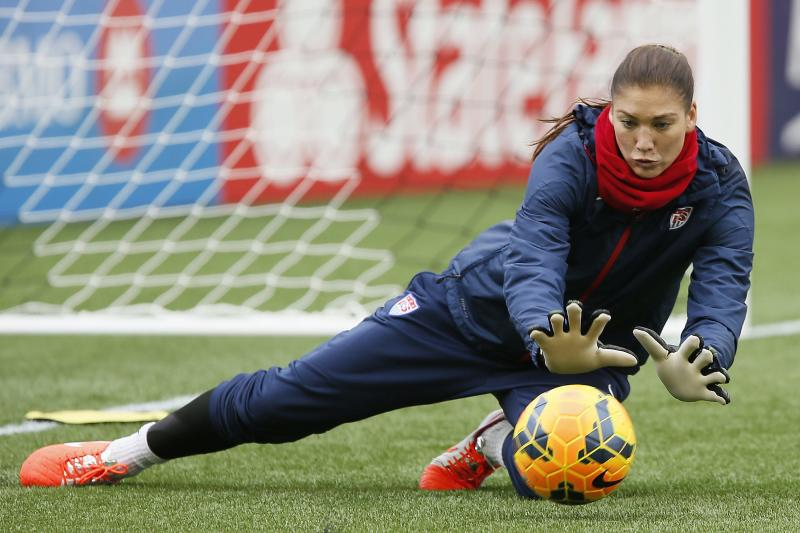 Team USA goalkeeper Hope Solo makes a save during soccer practice in Winnipeg on Wednesday, May 7, 2014. Team USA faces Canada in a friendly match on Thursday, May 8 in Winnipeg