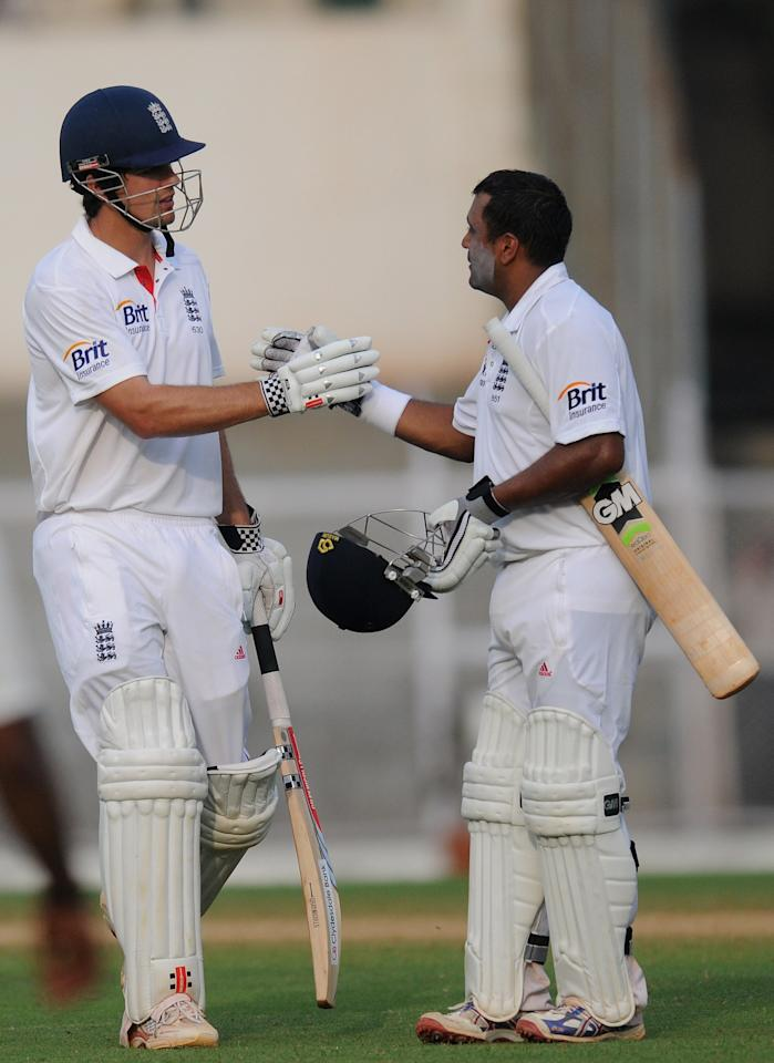 MUMBAI, INDIA - OCTOBER 31: Samit Patel of England (R) and team captain Alastair Cook greet each other at the end of the days play on second day of the first practice match between England and India 'A' at the CCI (Cricket Club of India) ground, on October 31, 2012 in Mumbai, India.  (Photo by Pal Pillai/Getty Images)