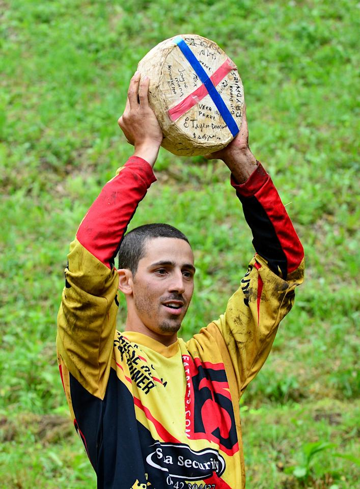 <p>Legendary cheese-chaser Chris Anderson hurled himself into the record books for chasing a wheel of Double Gloucester down a super-steep hill – in an annual tradition that is regularly dubbed 'Britain's barmiest race.' (SWNS) </p>