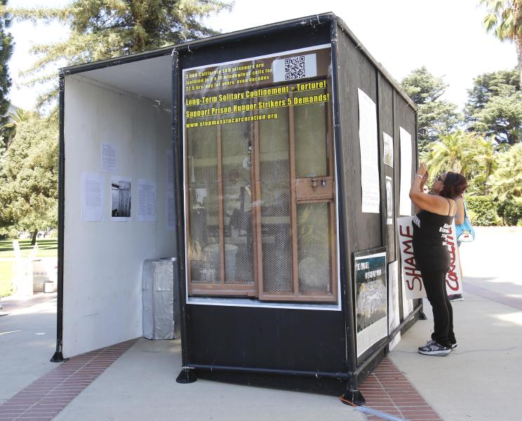 In this Wednesday Aug. 14, 2013, a life-sized replica of a Secure Housing Unit cell, is displayed at rally calling for the end of solitary confinement in California prisons, at the Capitol in Sacramento, Calif. California inmates have ended their nearly two-month hunger strike protesting the prison system's isolation policies, prison officials said Thursday, Sept. 5, 2013. All inmates began accepting prison-issued meals early Thursday, Corrections Secretary Jeffery Beard said.(AP Photo/Rich Pedroncelli)