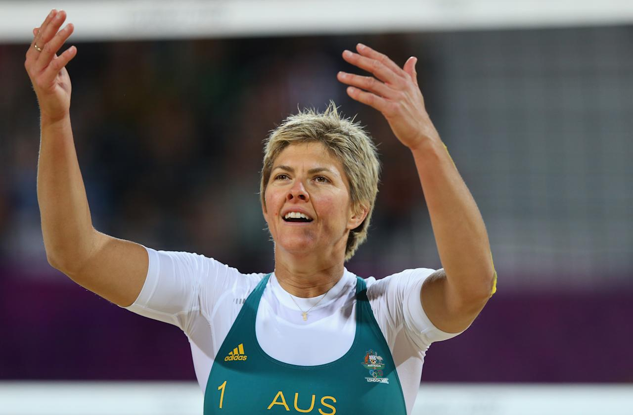 LONDON, ENGLAND - JULY 28:  Nat Cook of Australia reacts against the United States during the Women's Beach Volleyball Preliminary Round on Day 1 of the London 2012 Olympic Games at Horse Guards Parade on July 28, 2012 in London, England.  (Photo by Ryan Pierse/Getty Images)