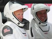 In this file photo taken on May 30, 2020 NASA astronauts Bob Behnken (R) and Doug Hurley prepare for lift-off to the International Space Station