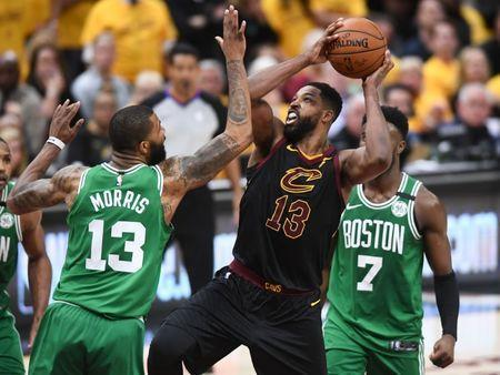 May 21, 2018; Cleveland, OH, USA; Cleveland Cavaliers center Tristan Thompson (13) drives against Boston Celtics forward Marcus Morris (13) during the forth quarter in game four of the Eastern conference finals of the 2018 NBA Playoffs at Quicken Loans Arena. Mandatory Credit: Ken Blaze-USA TODAY Sports