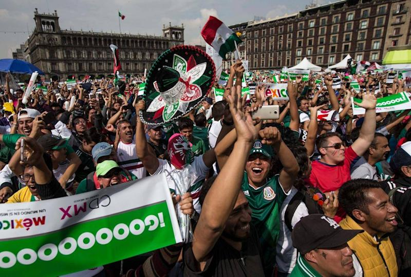 Fans celebrate Mexico's goal against Korea during their Russia World Cup soccer match (AP)