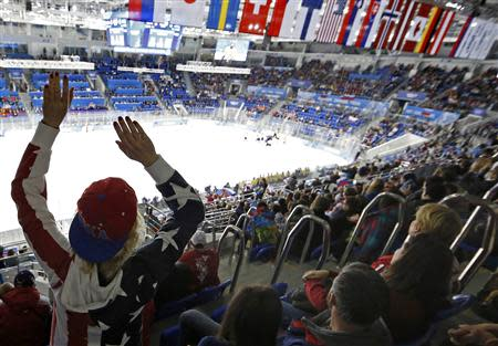 A hockey fan celebrates a goal by the U.S. against Sweden during a women's semi-final ice hockey game at the 2014 Sochi Winter Olympic Games, February 17, 2014. REUTERS/Jim Young