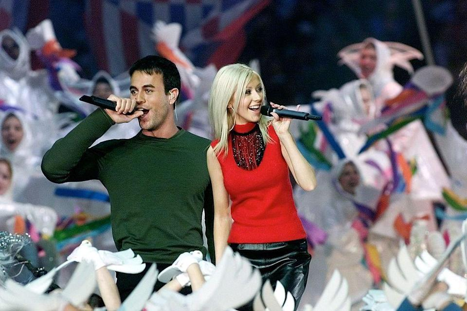 """<p>In a Disney-themed show, Christina Aguilera (in a leather skirt and red roll neck) sung with Enrique Iglesias.</p><p><a class=""""link rapid-noclick-resp"""" href=""""https://www.youtube.com/watch?v=6dWxq1D-B9s&ab_channel=OhMyChurro"""" rel=""""nofollow noopener"""" target=""""_blank"""" data-ylk=""""slk:WATCH NOW"""">WATCH NOW</a></p>"""