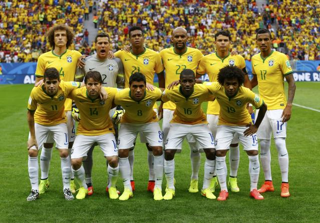 Brazil's players pose before their 2014 World Cup third-place playoff against the Netherlands at the Brasilia national stadium in Brasilia July 12, 2014. REUTERS/Dominic Ebenbichler (BRAZIL - Tags: SOCCER SPORT WORLD CUP)