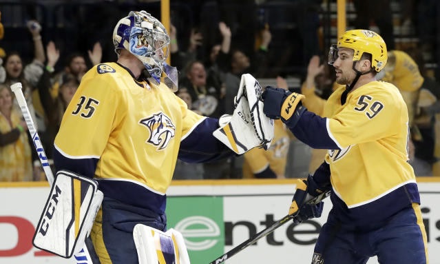 Nashville Predators goalie Pekka Rinne (35), of Finland, and defenseman Roman Josi (59), of Switzerland, celebrate after beating the Colorado Avalanche in Game 2 of an NHL hockey first-round playoff series Saturday, April 14, 2018, in Nashville, Tenn. The Predators won 5-4 to take a 2-0 lead in the series. (AP Photo/Mark Humphrey)