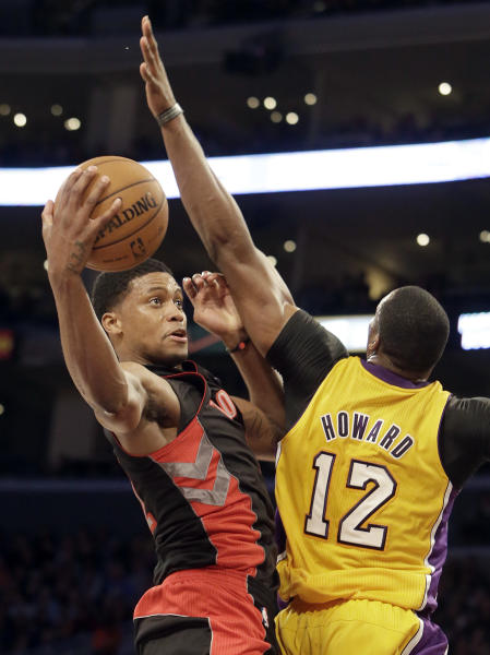 Toronto Raptors forward Rudy Gay shoots as Los Angeles Lakers center Dwight Howard (12) defends in the first half of an NBA basketball game in Los Angeles Friday, March 8, 2013. (AP Photo/Reed Saxon)