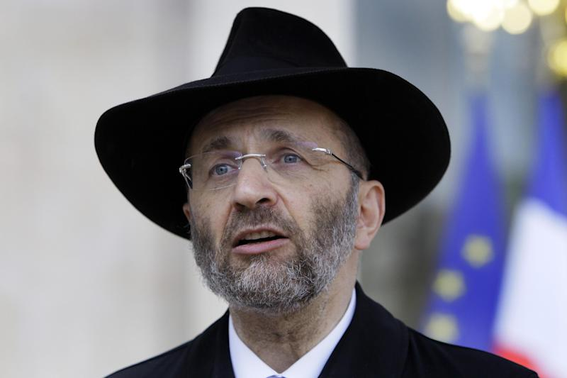 "FILE - In this July 12, 2012 file photo, France's Grand Rabbi Gilles Bernheim talks to the media after his meeting with French President Francois Hollande at the Elysee Palace in Paris. French Jewish leaders were holding an urgent meeting to discuss the career fate of France's chief rabbi  Bernheim after he acknowledged ""mistakes"" amid allegations that he plagiarized texts and lied about his educational background.(AP Photo/Francois Mori, File)"