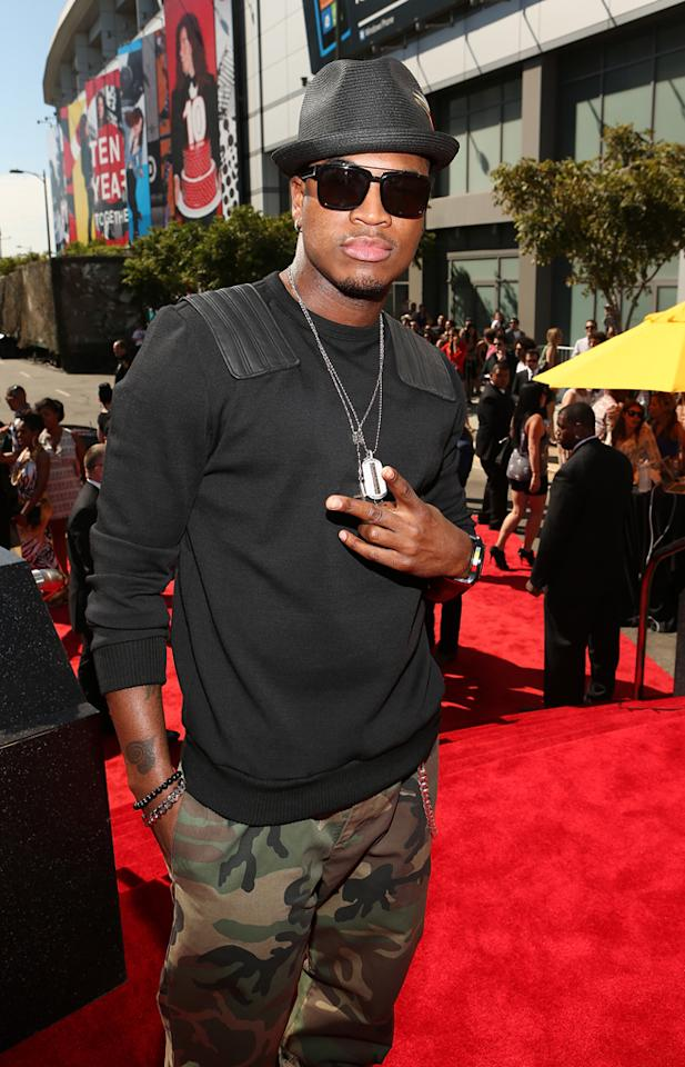 "Ne-Yo is prepared for battle -- except he's not nominated for any VMAs this year. The ""Give Me Everything"" singer donned camouflage pants, a black sweater (in the Los Angeles heat), and dog tags for the big award show."
