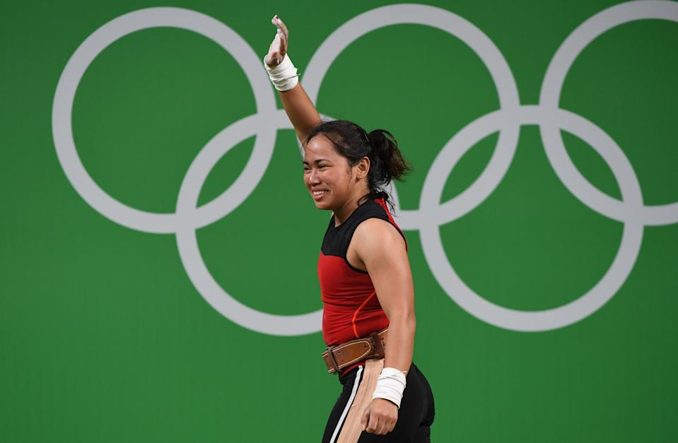 Philippines' Hidilyn Diaz celebrates during the women's 53kg weightlifting event at the Rio 2016 Olympic games in Rio de Janeiro on August 7, 2016. / AFP / GOH Chai Hin        (Photo credit should read GOH CHAI HIN/AFP via Getty Images)