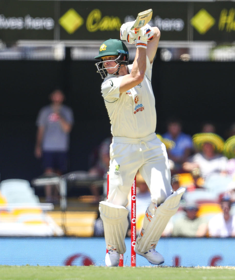 Australia's Steve Smith bats during play on the first day of the fourth cricket test between India and Australia at the Gabba, Brisbane, Australia, Friday, Jan. 15, 2021. (AP Photo/Tertius Pickard)