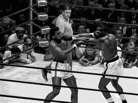Cassius Clay (L) and Sonny Liston face off in a WBA/WBC World Heavyweight fight in this Miami Herald photo from HistoryMiami taken in Miami Beach, Florida February 25, 1964. REUTERS/Miami Herald/HistoryMiami/Handout