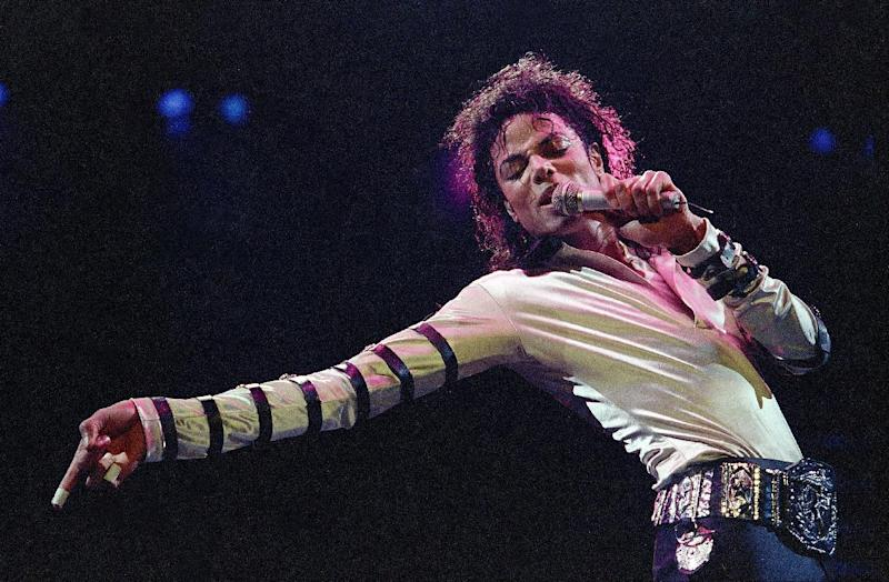 "In this Feb. 24, 1988 file photo, Michael Jackson leans, points and sings, dances and struts during the opening performance of his 13-city U.S. tour, in Kansas City. Some key figures who helped manage Michael Jackson's career are teaming up to create a musical about the behind-the-scenes making of a superstar that producers call a cross between ""Goodfellas"" and ""Dreamgirls."" ""The Man,"" with a book by Lamica and Grammy Award-winning composer Hart, is expected to open in Las Vegas in the late fall of 2013. (AP Photo/Cliff Schiappa, File)"