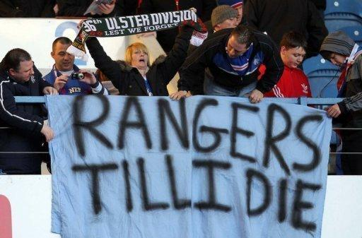 Rangers' fans show their support for the club during the Scottish Premier League match between Rangers and Kilmarnock at Ibrox Stadium in Glasgow on February 18. Chairmen of rival clubs arrived for a meeting regarding the future of financially stricken Glasgow giants Rangers insisting it would not be the end of Scottish football if they were demoted to the Third Division