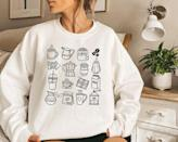 """<p><strong>TheImaginaryFriend1</strong></p><p>etsy.com</p><p><strong>$32.99</strong></p><p><a href=""""https://go.redirectingat.com?id=74968X1596630&url=https%3A%2F%2Fwww.etsy.com%2Flisting%2F1067245169%2Fcoffee-sweatshirt-vintage-fall-hoodie&sref=https%3A%2F%2Fwww.goodhousekeeping.com%2Fholidays%2Fgift-ideas%2Fg29250426%2Fgifts-for-coffee-lovers%2F"""" rel=""""nofollow noopener"""" target=""""_blank"""" data-ylk=""""slk:Shop Now"""" class=""""link rapid-noclick-resp"""">Shop Now</a></p><p>Oversized sweatshirts are always in style, and this cozy coffee-themed pullover is perfect for the holidays.</p>"""