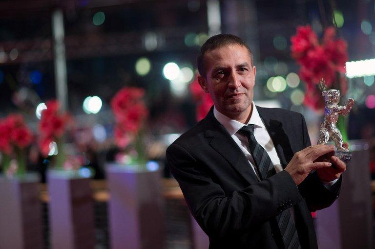 """Nazif Mujic holds the Silver Bear best actor award for his performance in """"An Episode in the Life of an Iron Picker"""" on February 16, 2013. He is the real-life protagonist of the picture about a Roma couple denied life-saving medical treatment"""