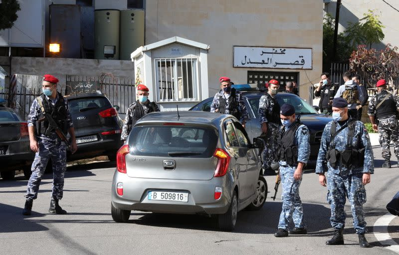 Members of the Lebanese police gather outside Baabda prison